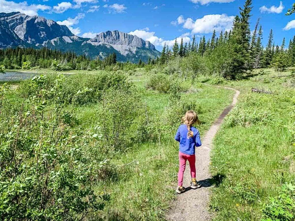 girl walking in Meadow along Middle Lake Interpretive Trail