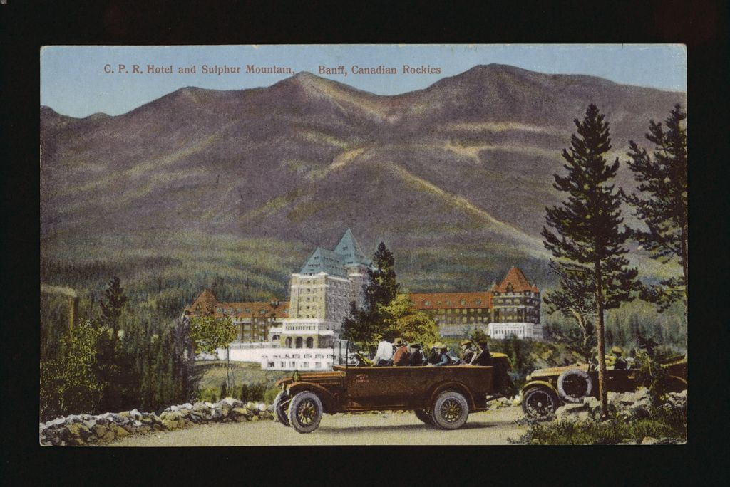A Rocky Mountain Tours automobile stops for a view of Banff Springs Hotel and Sulphur Mountain in the Canadian Rockies