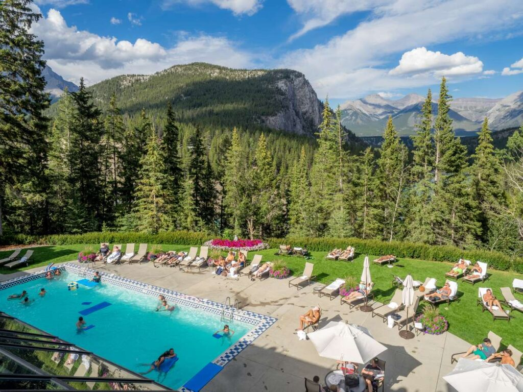 In summer, one of the best reasons to stay at the Banff Springs Hotel is their outdoor pool with spectacular rocky mountain views