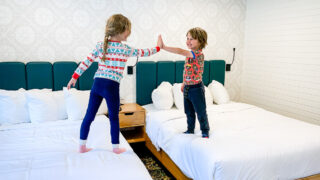 Kids giving high five at Dorothy Motel - accommodations in banff