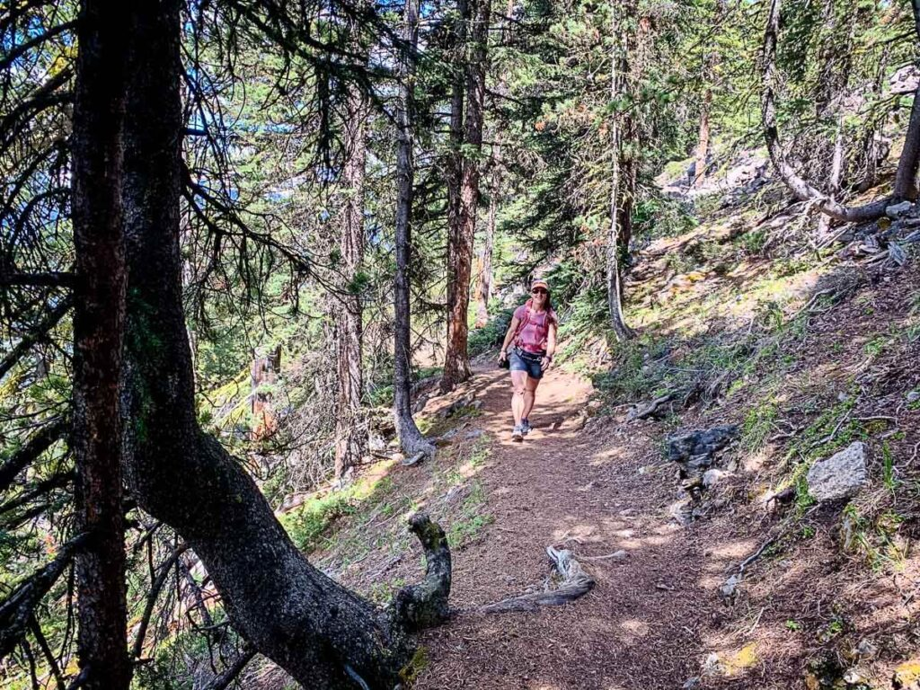 woman hiking to Castle Lookout with backpack and bear spray in scat belt