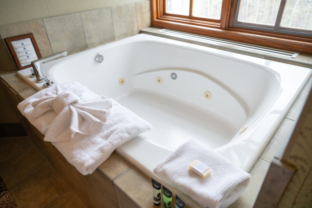 Enjoy a 2-person private jetted tub at the Banff Caribou Lodge on Banff Avenue