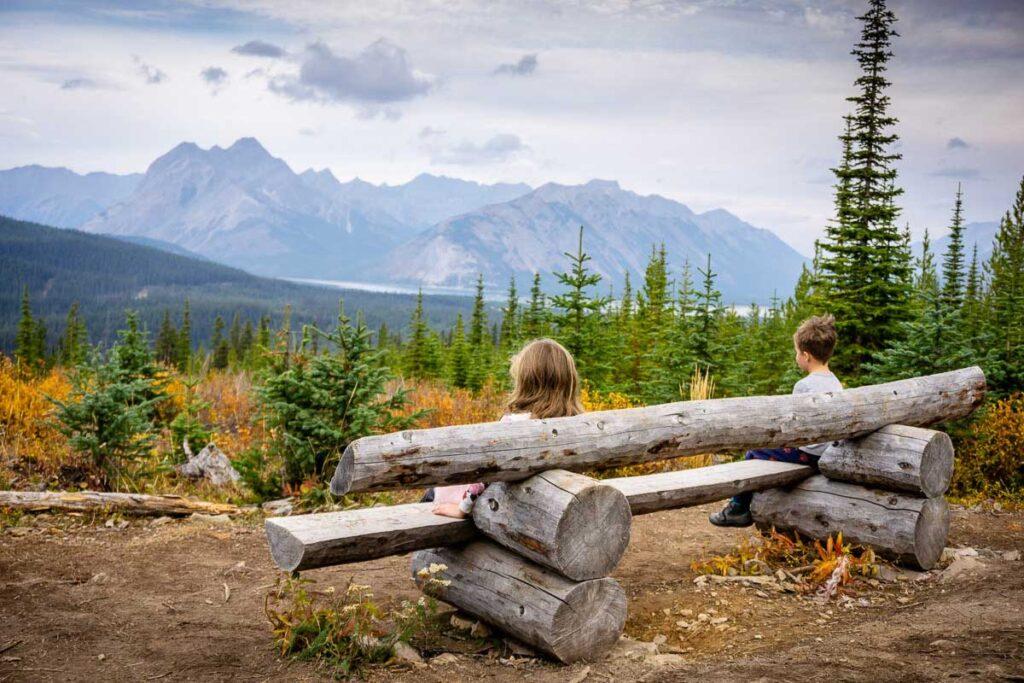 children sitting on bench along Rummel Lake hiking trail