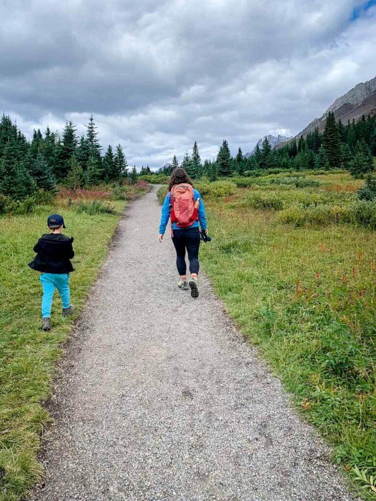 mother and boy hiking Highwood Meadows Kananaskis