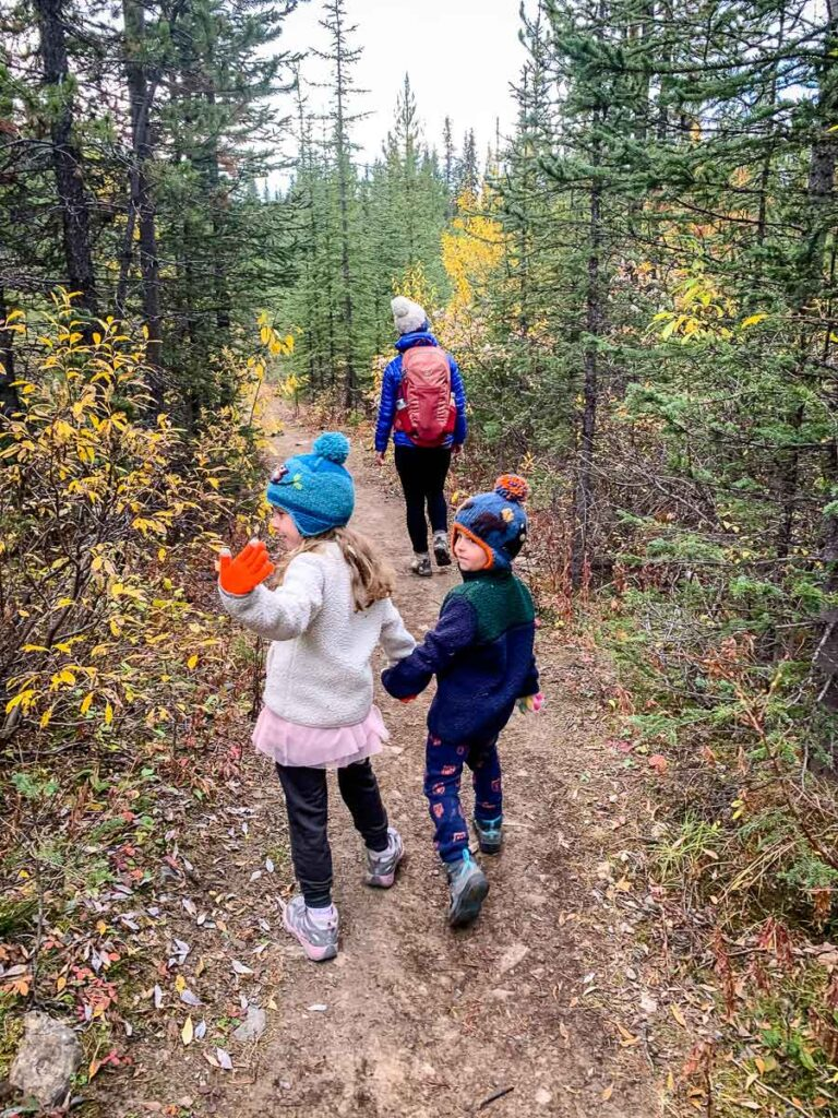 family hiking Rummel Lake trail Kananaskis Alberta