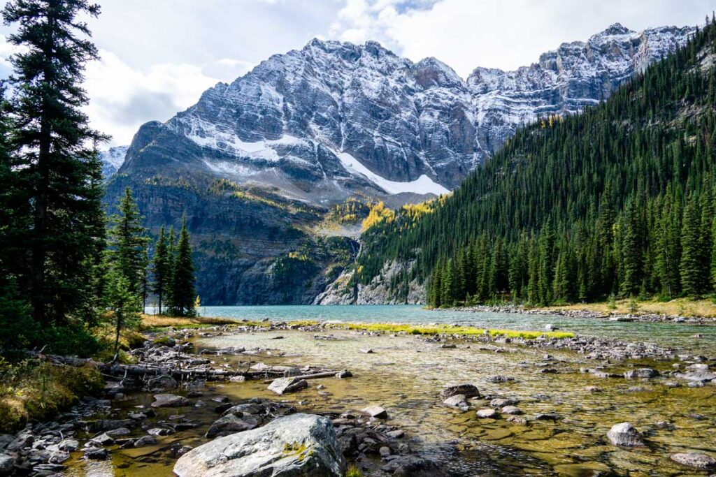 A river runs from the Lower Twin Lake in Banff National Park