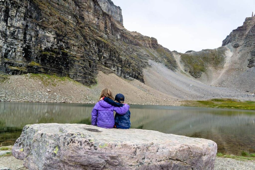 kids sitting on rock at Minnestimma lakes after Larch Valley hike