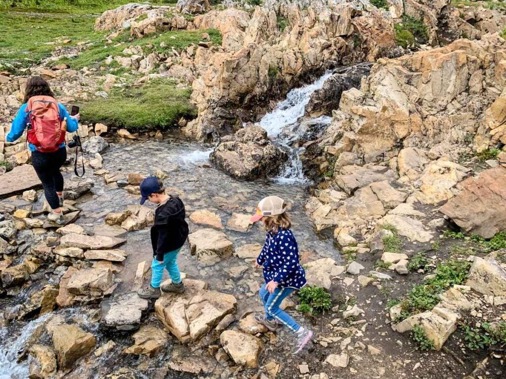 mother and kids hiking Ptarmigan Cirque in Kananaskis