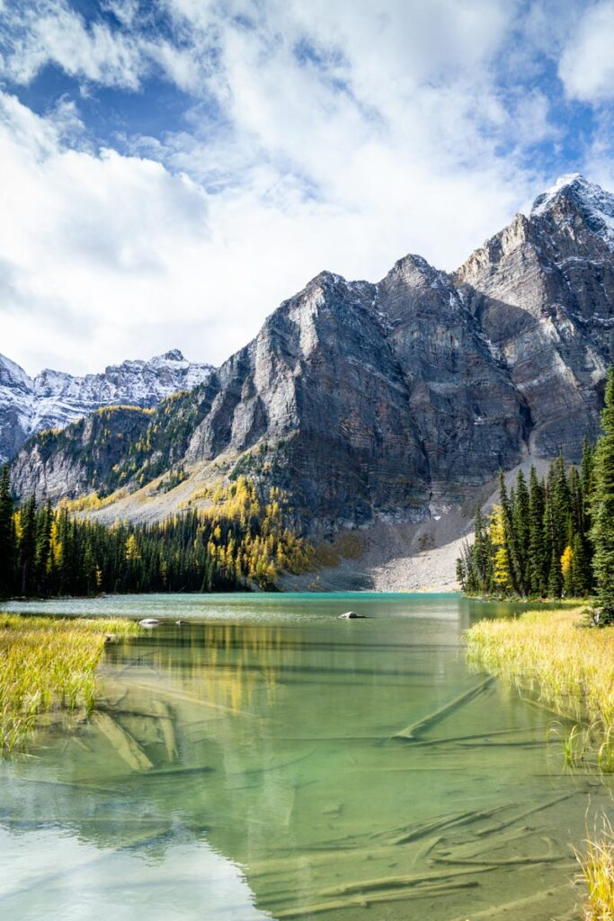 A river flows from one of the Twin Lakes in Banff